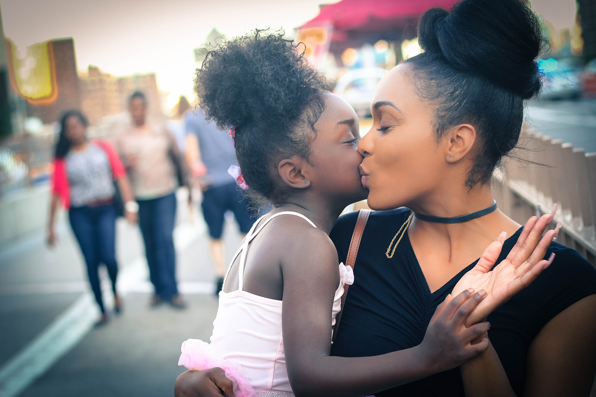 mom kissing young child